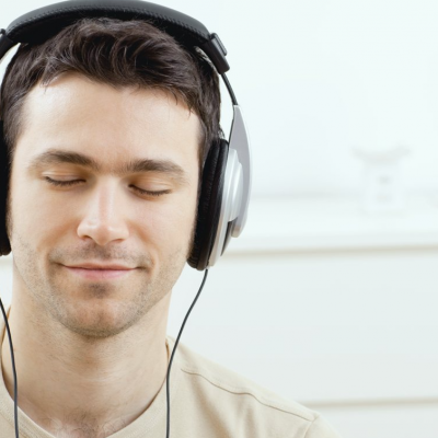 man meditating headphone